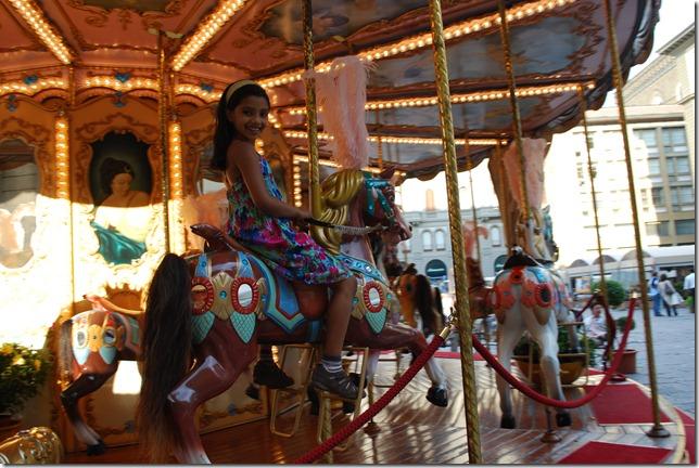 Rhea Shinde on a carousel in Florence