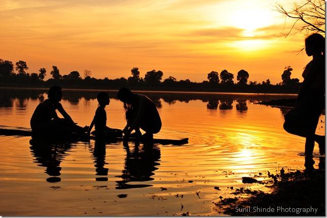 Khmer women bathing at Srah Srang
