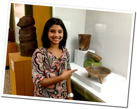 001 Rhea at the Popul Voh Museum in Guatemala City, Guatemala, Pointing to a pot similar to one we have at home